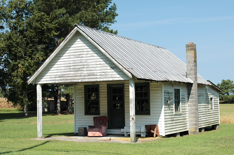 Small rural frame house with gable type porch